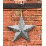 A medium Greywashed Wooden Barn Star