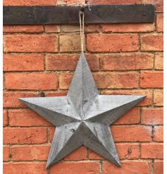 This extra large grey wood hanging barn star is sure to make a rough luxe look
