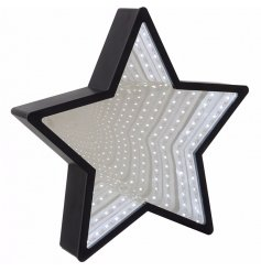 This glam inspired mirrored star will add the perfect glow to any modern chic living home