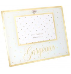 A mirrored photo frame with polka dots & gorgeous motto
