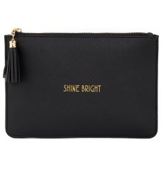 "A glamorously styled black faux leather clutch bag with a chic gold ""Shine Bright"" quote"
