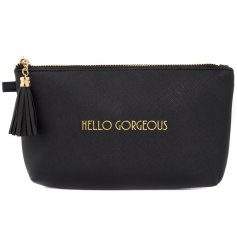 "A glamorously styled black faux leather cosmetic bag with a chic gold ""Shine Bright"" quote"
