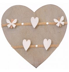 A wooden heart memo board with pegs