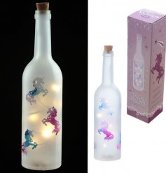 Add a magical unicorn glow to a bedroom space with this LED frosted bottle