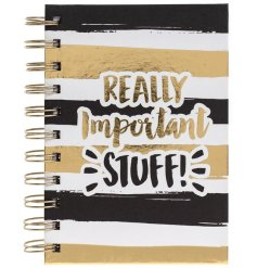 A fabulous hard back notebook with a black and gold decal