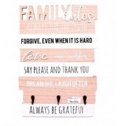 Always remember the family rules with this chic wooden wall plaque