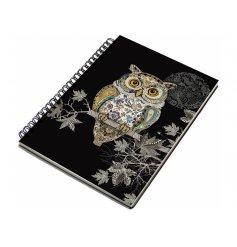 An A6 owl notebook