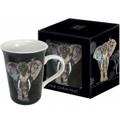 An artistic painted elephant on a mug in a gift box