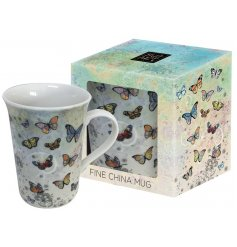 An butterfly patterned Mug In a Box