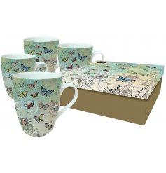 A set of 4 butterfly patterned Mugs In a Box