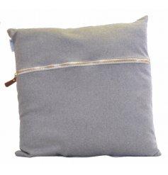 An assortment of 2 grey felt cushions with chunky zips