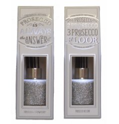 An assortment of 2 glittery reed diffusers with prosecco scent