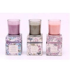 An assortment of 3 candle pots in floral gift boxes