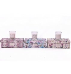 A pack of 3 floral glass candle pots in 3 assorted scents