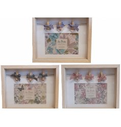 A sweet assortment of wooden peg frames, each complete with a colourful floral display and bow finishes