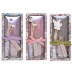 A floral themed assortment of scented clay reed diffusers