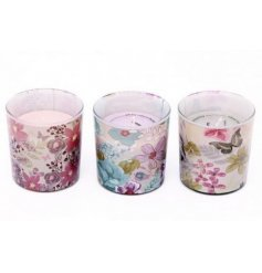 An assortment of 3 floral pattern candle pots