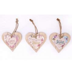 An assortment of 3 pretty floral double layered wooden heart plaques with jute rope to hang.
