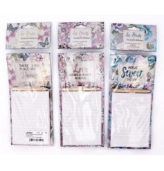 An assortment of 3 les fleurs magnetic notepads