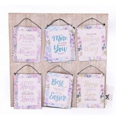 An assortment of 6 mini metal hanging signs with home, friendship, love and happiness slogans.