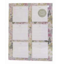A magnetic notepad set featuring floral design