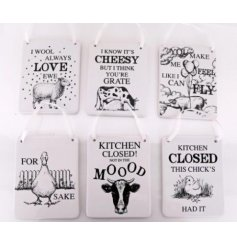 A quirky and comical assortment of printed ceramic plaques,