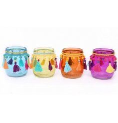 A quirky and colourful assortment of glass candle pots, each complete with a fluffy pompom addition