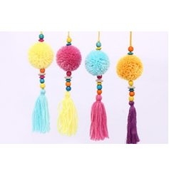 A quirky and colourful assortment of hanging fluffy pompoms