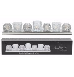 Bring a chic and vintage trend to your home with this beautiful set of glass tlight holders on a mirrored tray
