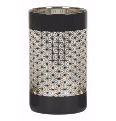 Add this chic gold and black toned tlight holder to any home for a classic luxe touch