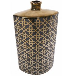Bring a darkened and chic style into your home with this golden and black toned contemporary vase