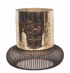 Bring a vintage chic touch to any home with this distressed golden pillar candle holder