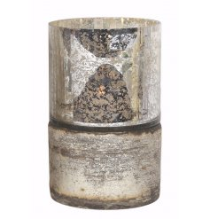 Bring a vintage chic touch to any home with this distressed silver pillar candle holder