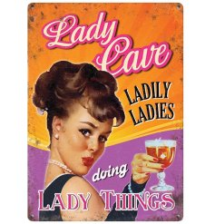 A mini metal sign with Lady Cave Design