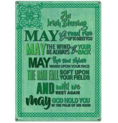 A green mini metal sign with an Irish blessing