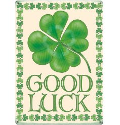 A mini metal sign with four leaf clover for luck