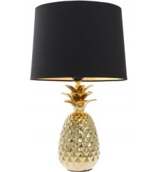 A modern home inspired side lamp, set in style with its chic gold pineapple base and strong black rounded lampshade
