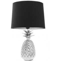 A modern home inspired side lamp, set in style with its chic silver pineapple base and strong black rounded lampshade