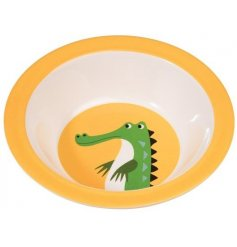 A bright yellow colourful creatures bowl with green crocodile