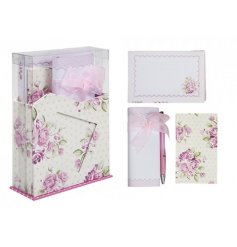A letter writing set in stand featuring pink rose design