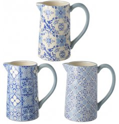 An assortment of 3 Blue mosaic Ceramic Jugs