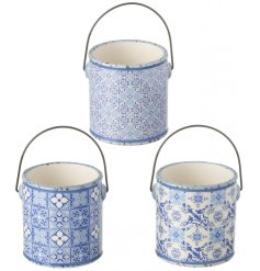 A beautifully chic assortment of 3 blue patterned ceramic planters with handles