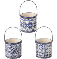 A chic assorted mix of vintage inspired ceramic pots, each finished with delicate blue pattern
