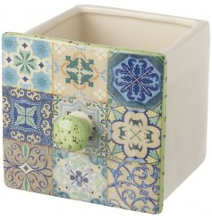 Bring a boho chic touch to your living spaces or garden with this stylishly colourful draw planter