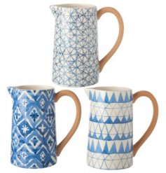 An assortment of 3 Geometric Blue Ceramic Jugs