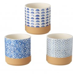 An on trend assortment of blue toned ceramic decorative planters