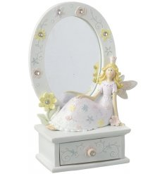 A sweet resin mirror frame complete with a posed fairy princess addition