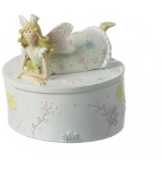 A sweet resin trinket box complete with a posed fairy princess addition