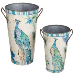 Bring a beautiful peacock themed touch to your home space with this metal blue decorative set of vases
