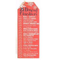 A large red wooden sign with 25 days of Christmas